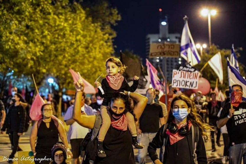 דיקלה וילדיה באחת ההפגנות. צילום בן כהן